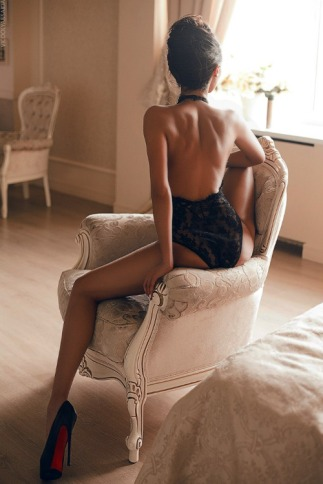 girl in chair escort benidorm black backless teddy high heels with red soles